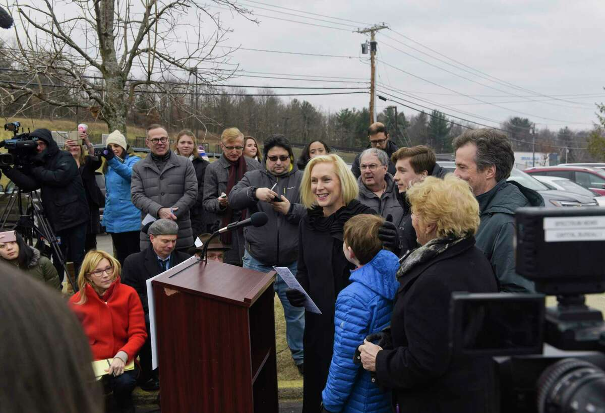 Presidential candidate, U.S. Sen. Kirsten Gillibrand, with her husband, sons, and mother by her side, talks to a large gathering of media outside the Country View Diner on Wednesday, Jan. 16, 2019, in Brunswick, N.Y. Gillibrand came to the diner with family and friends the day after making an announcement on The Late Show with Stephen Colbert that she would be running for President in 2020. (Paul Buckowski/Times Union)