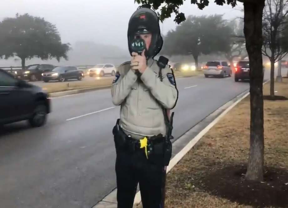 Officials with the Williamson County Sheriff's Office are getting creative trying to reduce speeding in local neighborhoods. The department posted a life-size, cardboard cut out sign of a deputy holding a radar gun that looks like the real thing in hopes to reduce reckless driving in school zones. Photo: Williamson County Sheriff Robert Chody