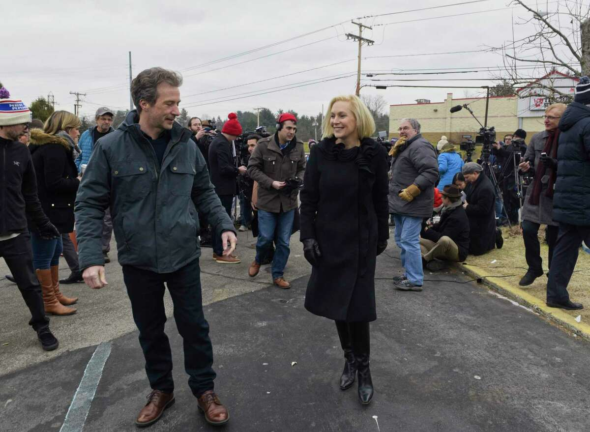 Presidential candidate, U.S. Sen. Kirsten Gillibrand, and her husband Jonathan, walk away from a large gathering of media following a press conference outside the Country View Diner on Wednesday, Jan. 16, 2019, in Brunswick, N.Y. Gillibrand came to the diner with family and friends the day after making an announcement on The Late Show with Stephen Colbert that she would be running for President in 2020. (Paul Buckowski/Times Union)