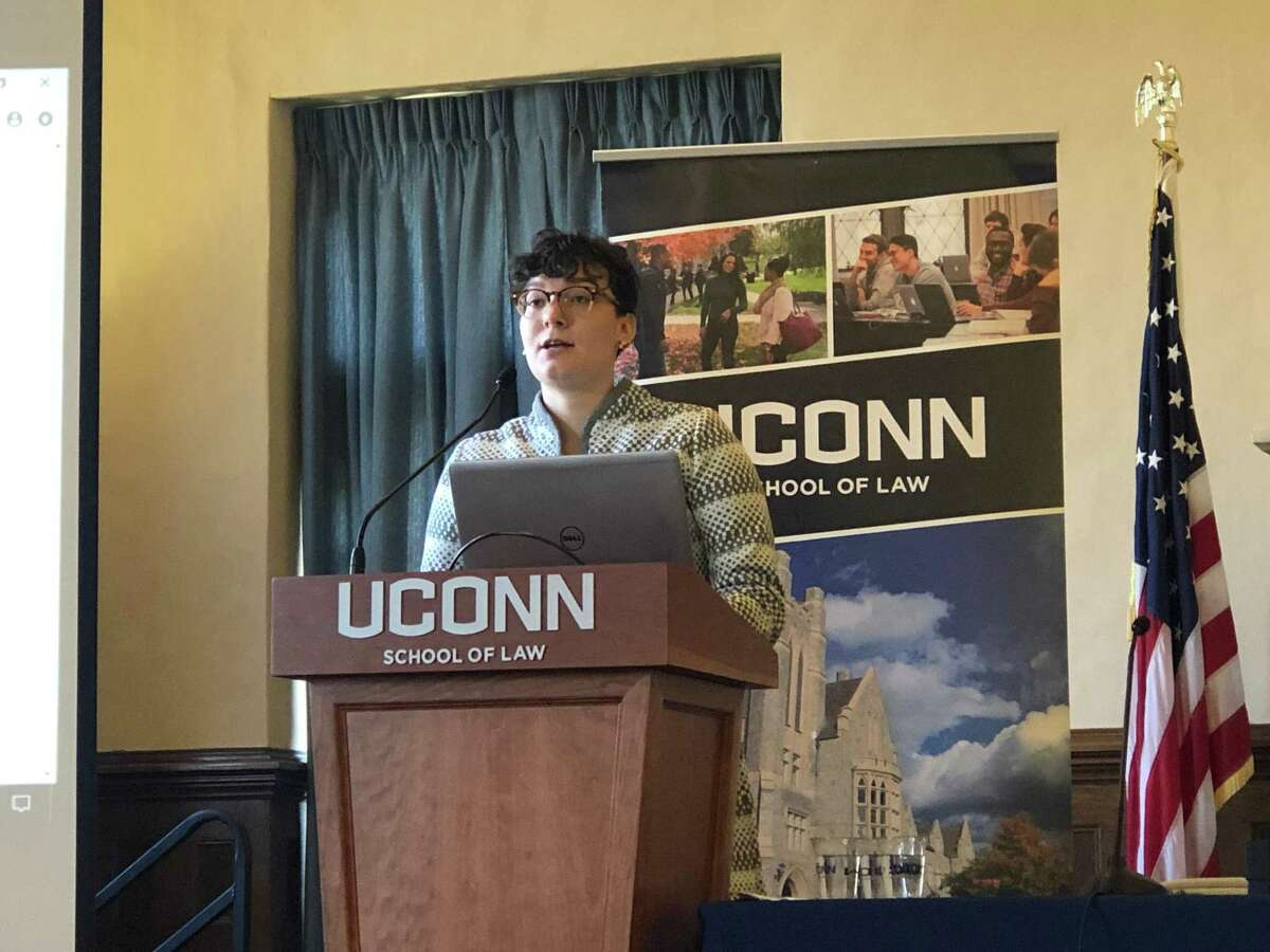 Michelle Carroll, associate director of external programming at End Rape on Campus, speaks at Campus Sexual Assault Prevention Conference at the University of Connecticut School of Law in Hartford on Tuesday.