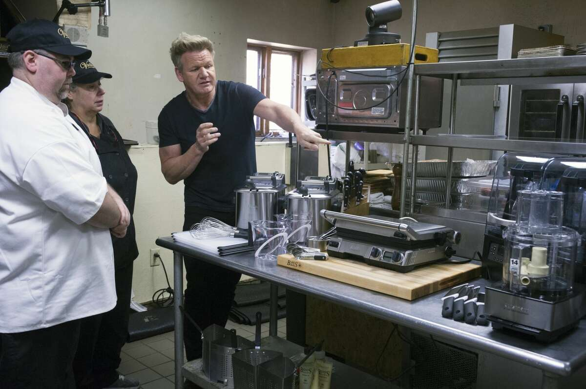 """Host/chef Gordon Ramsay (L) with the restaurant staff in the all-new Vasi's Restaurant and Bar episode of """"Gordon Ramsay's 24 Hours to Hell and Back."""""""