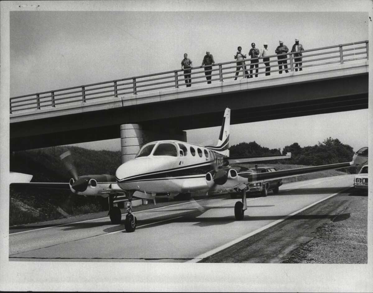 Airplane makes emergency landing on New York Thruway insterstate. June 18, 1975 (Arnold LeFevre/Times Union Archive)