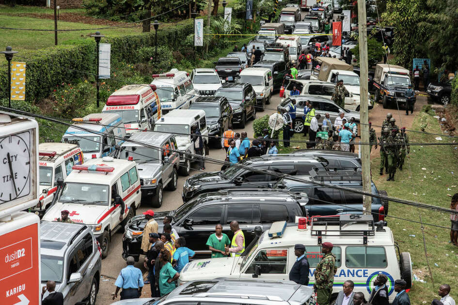AIROBI, KENYA - JANUARY 16: Emergency vehicles sit outside of the Dusit Hotel on January 16, 2018 in Nairobi, Kenya. A security operation has continued into a second day after Al-Shabab militants stormed the hotel, killing at least 15 people. (Photo by Andrew Renneisen/Getty Images)