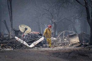 A firefighter searches a burned-out building in Paradise, Calif., on Nov. 15, 2018.