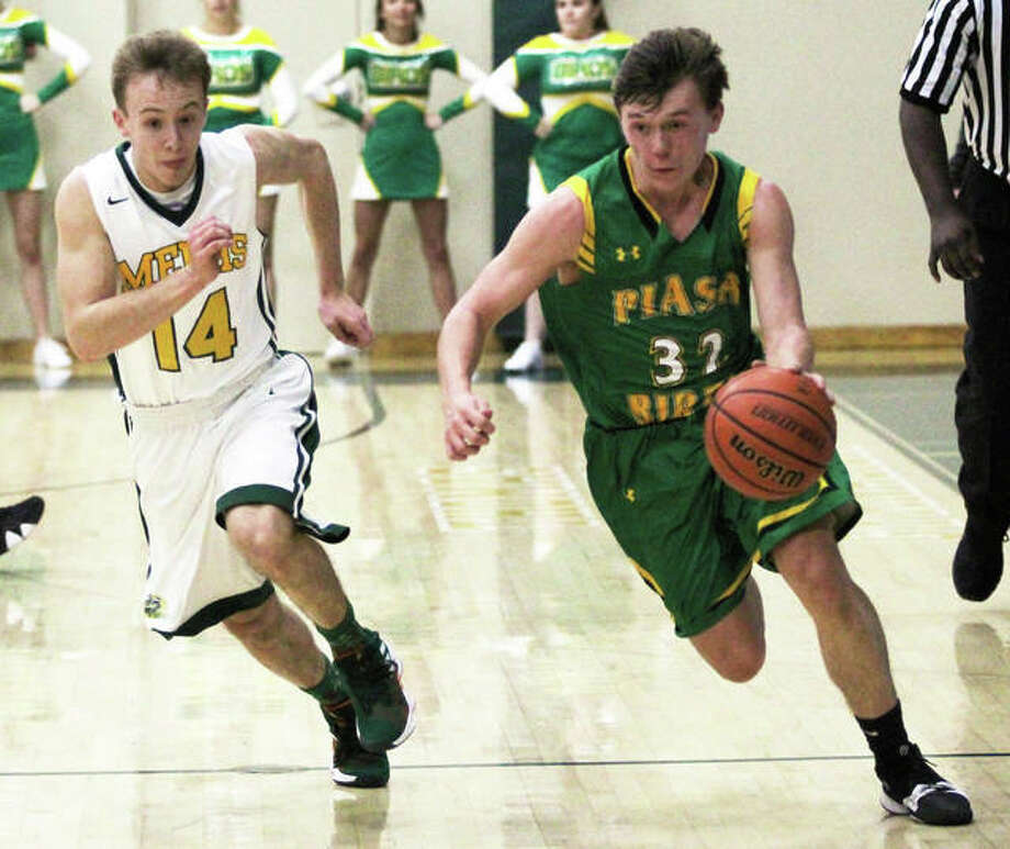 Southwestern's E.J. Kahl (right), shown bringing the ball upcourt past a Metro-East Lutheran defender in a tournament game Nov. 16 in Edwardsville, scored eight points Tuesday night in the Piasa Birds' victory over Bunker Hill at the Macoupin County Tournament in Mount Olive. Photo: Greg Shashack / The Telegraph