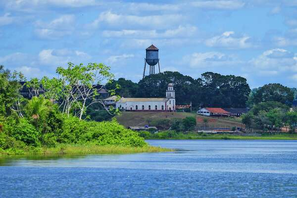 A general view of the Fordlandia from the Rio Tapajos on July 5, 2017 in Aveiro, Brazil. American industrialist Henry Ford negotiated the rights to 2.5 million acres of land from the Brazilian government to establish a rubber plantation. Construction started in 1926 with the hopes of employing 10,000 workers. By 1945 the project was considered a failure and the land was given back to the Brazilian government. (Photo by Joel Auerbach/Getty Images)