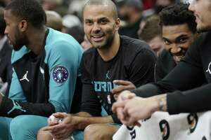 Charlotte Hornets' Tony Parker laughs on the bench during the second half of an NBA basketball game against the San Antonio Spurs, Monday, Jan. 14, 2019, in San Antonio. Charlotte won 108-93. (AP Photo/Darren Abate)