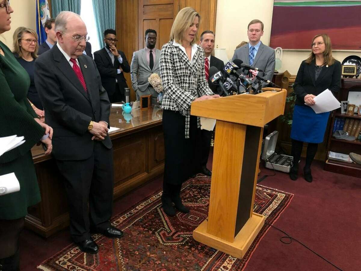 Indivisible Greenwich co-founder Joanna Swomley speaking at press conference of Secretary of State Denise Merrill, state legislative leaders and supporters of the Early Voting Amendment. Secretary Merrill is pictured on the right.