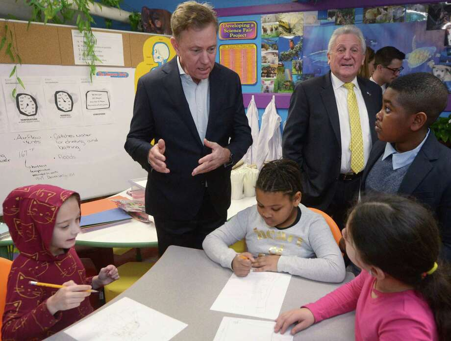 Governor Ned Lamont, left, and Norwalk Mayor Harry Rilling tour a Tracey Elementary School science lab with the help of 5th grader Adrien Danso, right, Wednesday January 16, 2019, prior to a roundtable discussion hosted by the Dalio Foundation at the school in Norwalk, Conn. The event highlighted the forthcoming release of a report from The Aspen Institute National Commission on Social, Emotional, and Academic Development titled, From a Nation at Risk to a Nation at Hope, which outlines steps officials should take to improve public education in the United States. Photo: Erik Trautmann / Hearst Connecticut Media / Norwalk Hour