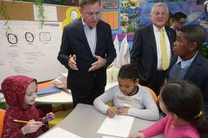 Governor Ned Lamont, left, and Norwalk Mayor Harry Rilling tour a Tracey Elementary School science lab with the help of 5th grader Adrien Danso, right, Wednesday January 16, 2019, prior to a roundtable discussion hosted by the Dalio Foundation at the school in Norwalk, Conn. The event highlighted the forthcoming release of a report from The Aspen Institute National Commission on Social, Emotional, and Academic Development titled, From a Nation at Risk to a Nation at Hope, which outlines steps officials should take to improve public education in the United States.