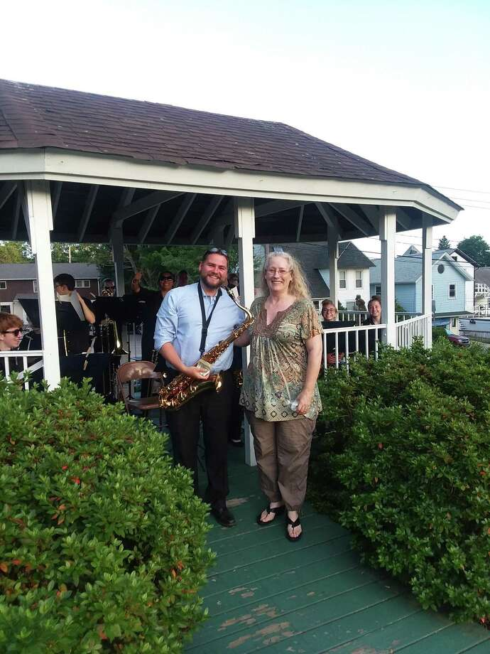 The East Hampton High School Music Department recieves a donation to support music education during the July 5 Joseph N. Goff House Museum Gazebo Concert. The Goff House is seeking additional volunteer board members to help with its annual events, including the gazebo concert series. Photo: Contributed Photo /