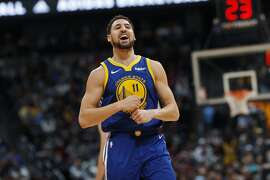 Golden State Warriors guard Klay Thompson reacts after hitting a basket against the Denver Nuggets late in the second half of an NBA basketball game, Tuesday, Jan. 15, 2019, in Denver. The Warriors won 142-111. (AP Photo/David Zalubowski)
