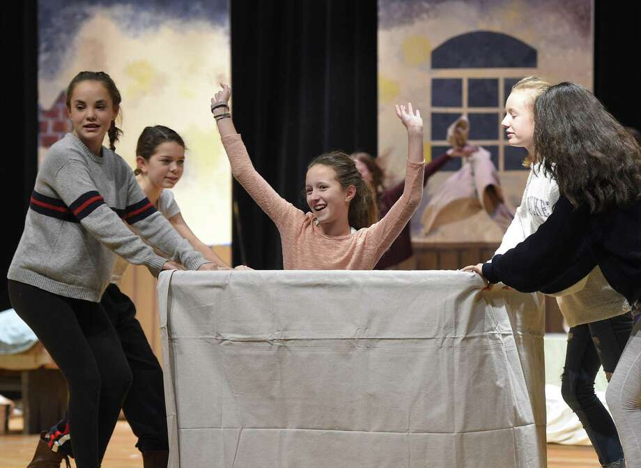"""Eighth-graders rehearse for this week's performances of """"Annie"""" at Eastern Middle School in Greenwich. The performances take place in the school's Lee Book Auditorium at 4:30 p.m. Thursday; 7:30 p.m. Friday; and at 7:30 p.m. Saturday. Tickets are sold in the main lobby of the school everyday from 7:15 to 7:45 a.m. Ticket reservations can be made via email by contacting tara_hoffman@greenwich.k12.ct.us. Photo: Tyler Sizemore / Hearst Connecticut Media / Greenwich Time"""