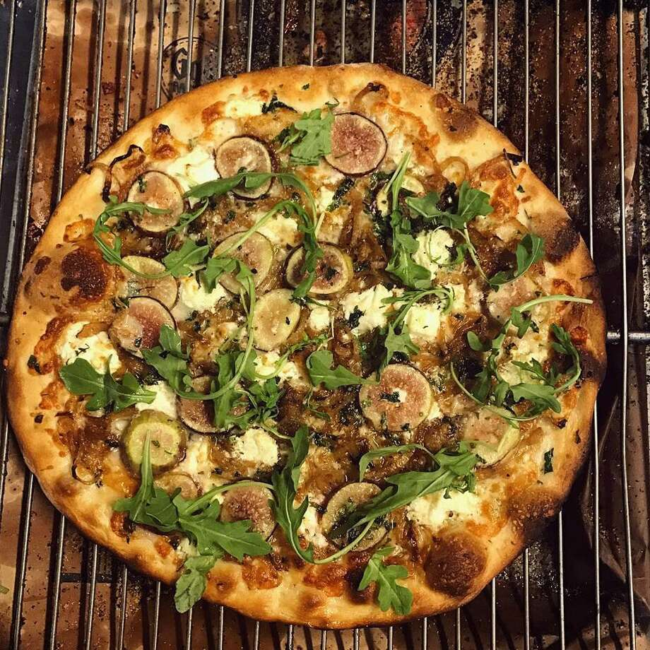 White pizza with figs, goat cheese, caramelized onions, mozzarella and optional arugula topping at Roseland Apizza in Derby. Photo: Contributed Photos