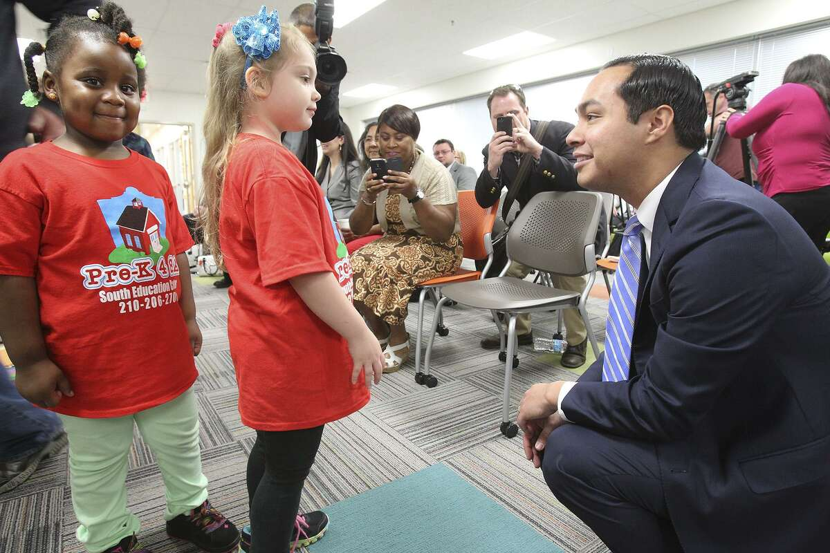 """Mye'Uniq Washington (left) and Zoe McClure meet Mayor Julian Castro at the Southside Pre-K4 SA center in 2014 as he announced plans for additional centers. Now that he's running for president, a flurry of national interest in the program has resulted - with some media outlets mistakenly labeling it """"universal"""" Pre-K."""