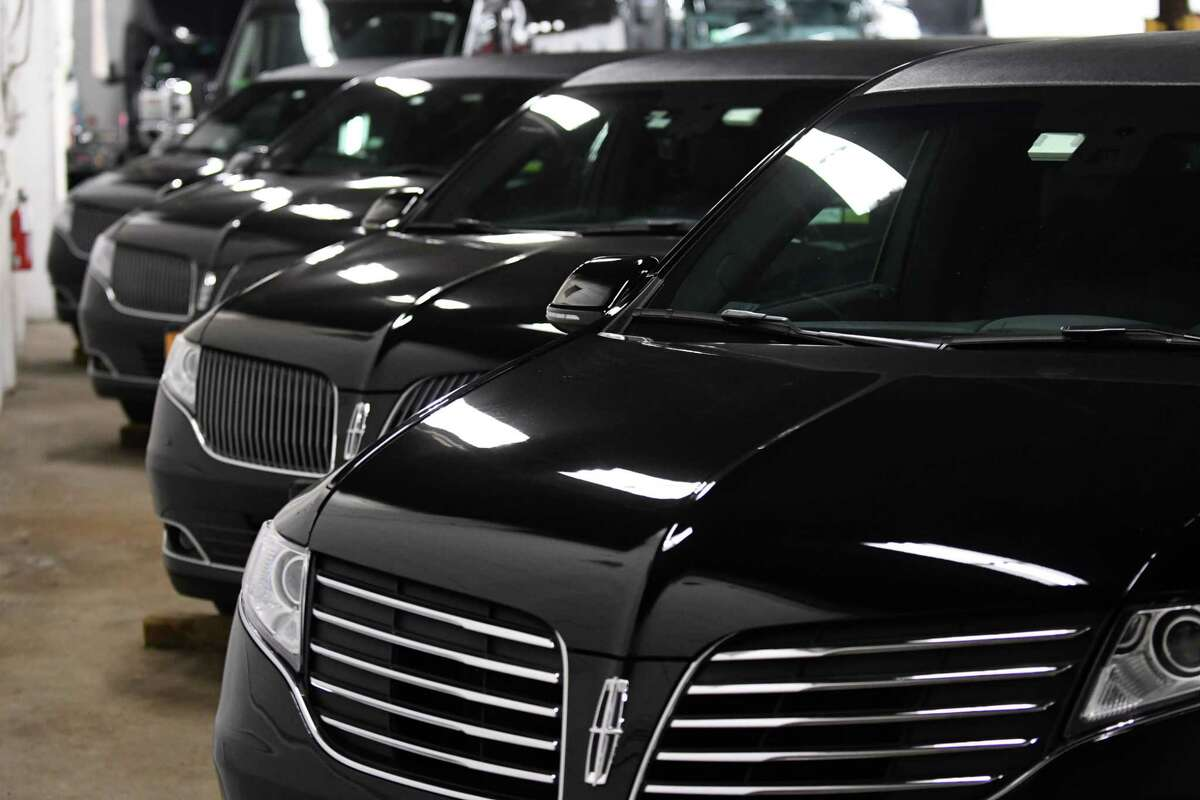 Limousines are parked at Premiere Transportation on Wednesday, Jan. 16, 2019, in Albany, N.Y. Gov. Andrew Cuomo has proposed a ban on