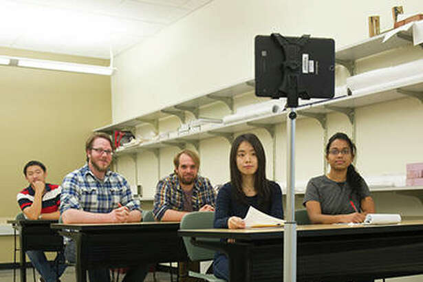 SIUE School of Engineering student researchers test the telepresence robot created for educational settings.