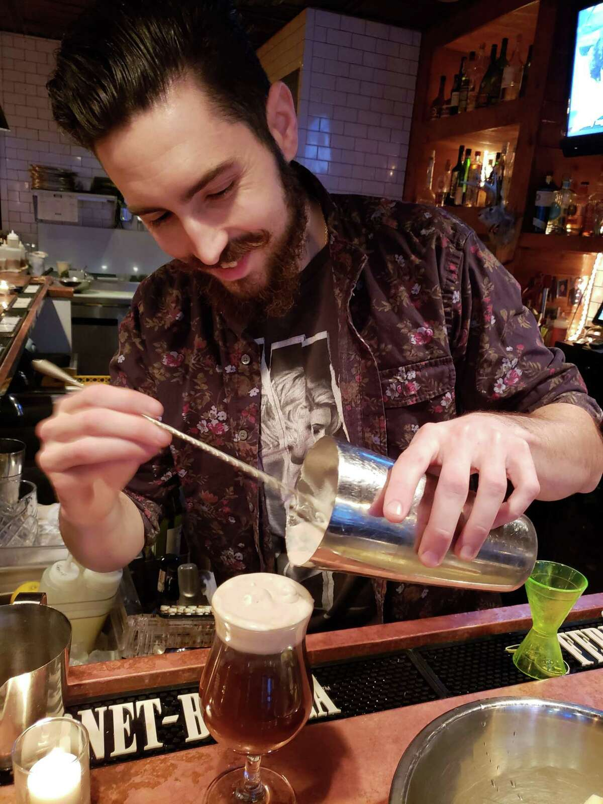 Bar Sugo mixologist Seth Hiravy, tall with a full beard and curling mustache, has an encyclopedic knowledge of mixology and speaks with authority about current trends in the cocktail business.