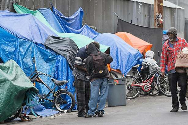 Homeless people set up tarps and tents in downtown Los Angeles in May 2016. (Brian van der Brug/Los Angeles Times/TNS)
