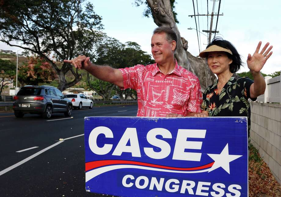 FILE - In this July 24, 2018, photo, U.S. House candidate Ed Case and his wife, Audrey Case, greet evening commuters while campaigning in Honolulu. Photo: Audrey McAvoy/AP / Copyright 2018 The Associated Press. All rights reserved. This material may not be published, broadcast, rewritten or redistributed without permission.