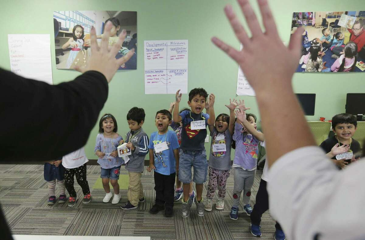 Pre-kindargarten students perform a song at the HEB Read 3 Family Literacy Workshop at Pre-K 4 SA on Oct. 31, 2018. The activity for the day was learning to understand nutrition labels and how to provide a healthy after-school snack. The program features activities that encourage parent engagement with their kids. Once a week for six weeks, parents attend the workshop for about an hour where they learn to enhance the child's educational experience at home. As an added incentive for parents, their children receive books at each session. (Kin Man Hui/San Antonio Express-News)