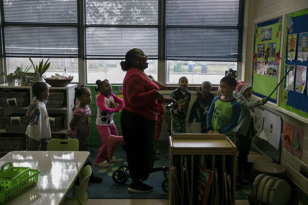 """Monica White leads her first grade students in a phonetics exercise during class at Carroll Early Childhood Education Center, Dec. 19, 2018. Carroll ECEC is leading what will eventually be a districtwide pre-k redesign that gives students more choices in their activities. The new way of teaching pre-K was designed by Carroll Principal Alejandra Barraza while she was getting her doctorate in early childhood education at UT, which allowed her the """"opportunity to turn the research into practice,"""" she says."""