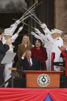 Texas Gov. Greg Abbott salutes the crowd during an inauguration ceremony at the State Capitol, Tuesday, Jan. 15, 2019. Abbott is serving a second term as governor. With him are his wife, Cecilia and daughter, Audrey. Lt. Gov. Dan Patrick was also given the oath of office during the ceremony.