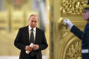FILE In this file photo taken on Thursday, April 5, 2018, Russian President Vladimir Putin enters a hall to chair a meeting of the State Council in the Kremlin in Moscow, Russia. U.S. and European sanctions have restricted Russiaís access to international capital markets, limited imports of Western energy and military technologies and spooked international investors. (AP Photo/Alexander Zemlianichenko, Pool, File)