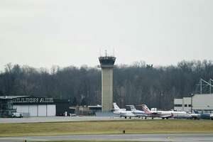 Furloughed government employees work in the air traffic control tower at the Westchester County Airport in White Plains, N.Y. Wednesday, Jan. 16, 2019. Academic journal publisher Mary Ann Liebert, Inc. provided a catered lunch to the air traffic controllers who have been working without pay due to the ongoing government shutdown.