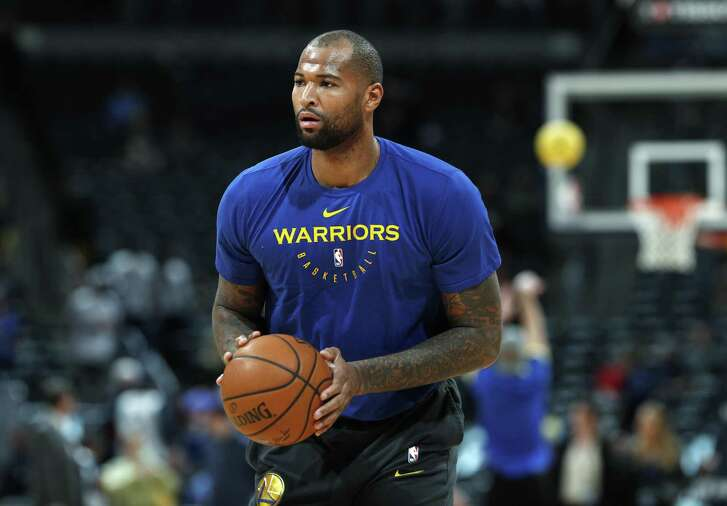 Injured Golden State Warriors center DeMarcus Cousins takes a shot as he works out before the Warriors face the Denver Nuggets on Tuesday.
