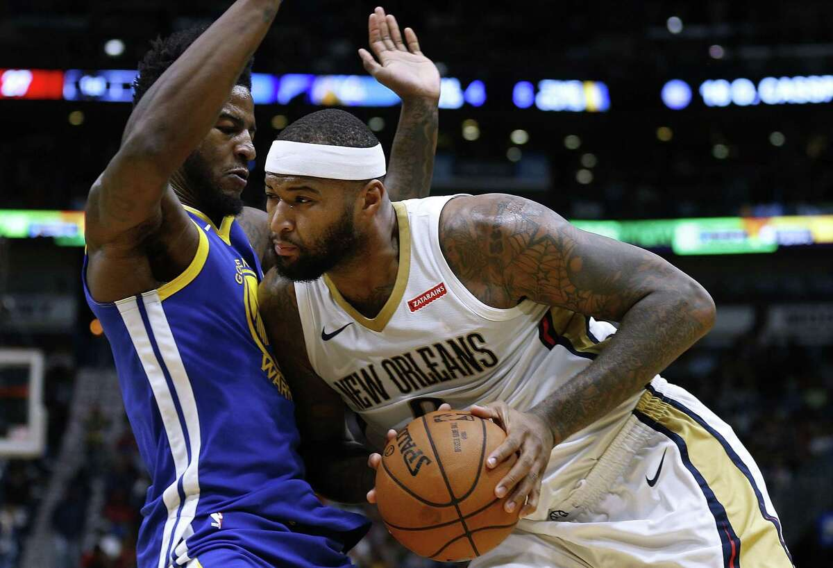DeMarcus Cousins of the New Orleans Pelicans drives against Jordan Bell of the Golden State Warriors in December 2017 in New Orleans.
