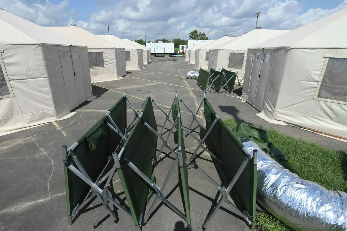 Tents and other temporary living facilities are being set up at the Port Arthur Civic Center parking lot to assist Tropical Storm Harvey evacuees with living needs. Photo taken Friday, September 15, 2017 Guiseppe Barranco/The Enterprise
