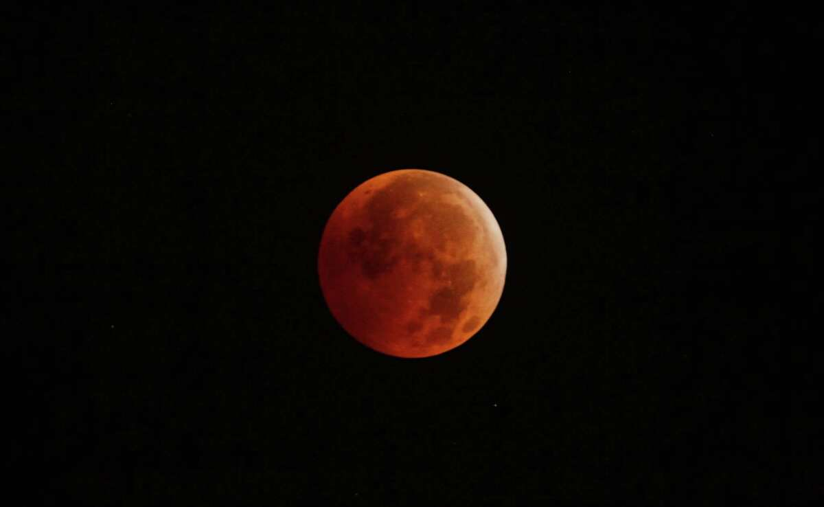 A total lunar eclipse occurs as the full moon is shadowed by the Earth on Dec. 21, 2010, in New York City.