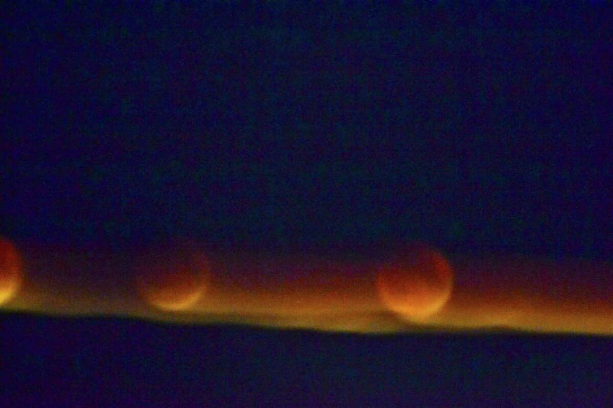 """Views of the supermoon lunar eclipse, or the """"blood moon"""" from Trumbull on Sept. 27, 2015."""