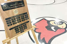 A plaque displaying names of top donors to the Alton Educational Foundation's Guardians of Education sits in the gym of Alton's Mark Twain School Wednesday morning.