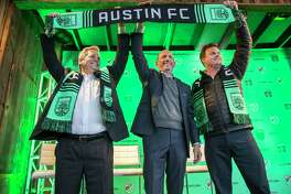 "Austin Mayor Steve Adler, Major League Soccer Commissioner Don Garber, and Anthony Precourt, majority owner of the team, from left, celebrate in downtown Austin, Texas, Tuesday, Jan. 15, 2019. The league formally welcomed Austin as its 27th franchise with a raucous downtown party full of chanting and flag-waving, and Garber calling the Texas capital a ""perfect fit."" MLS said Austin will begin play in the 2021 season. (Ricardo B. Brazziell/Austin American-Statesman via AP)"