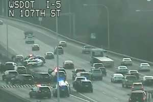 A police pursuit that happened after a reported robbery with alleged shots fired ended after the suspect crashed on southbound Interstate 5 at Northgate.