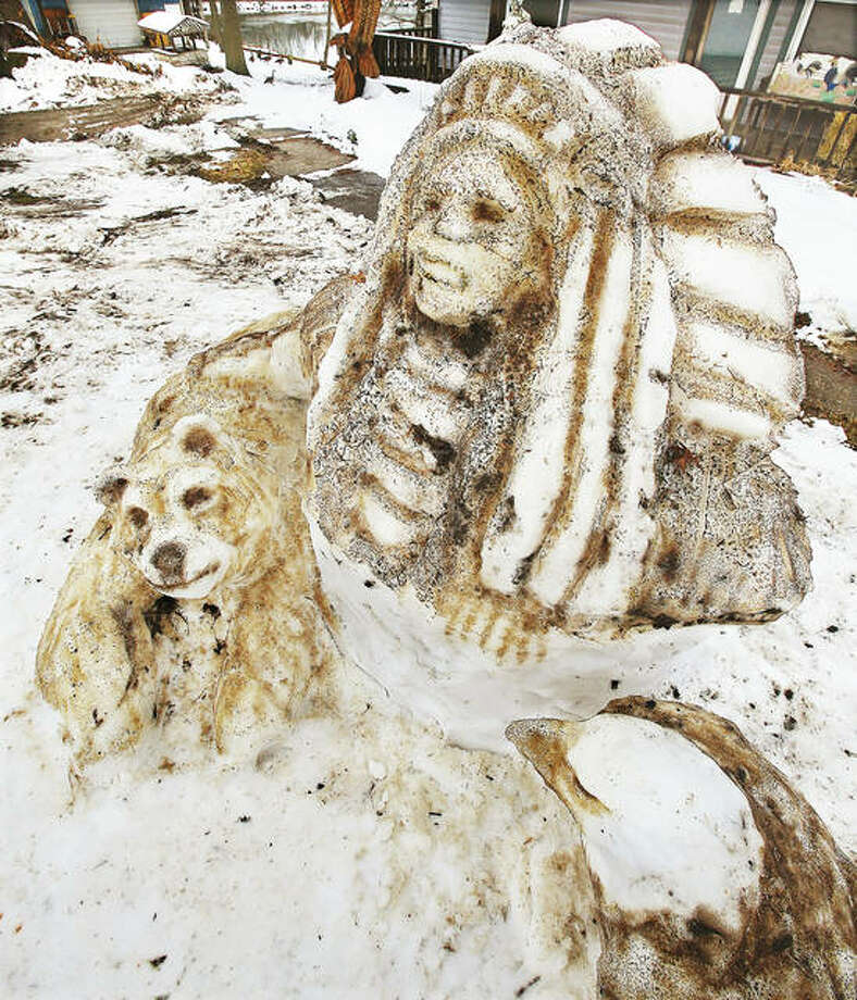 A mound of snow was sculpted into a Native American theme Wednesday, complete with an Indian chief, bear and a bald eagle on Seminary Road near Bryden Court in Godfrey. The front yard is known for hosting elaborate snow sculptures, and many motorists may remember The Incredible Hulk built there a few years ago. There may be plenty of snow for more sculptures with inches of snow forecast for the area Friday night into Saturday in a repeat of last weekend. The snow will be followed by a high temperature only in the teens on Sunday. Photo: John Badman | The Telegraph