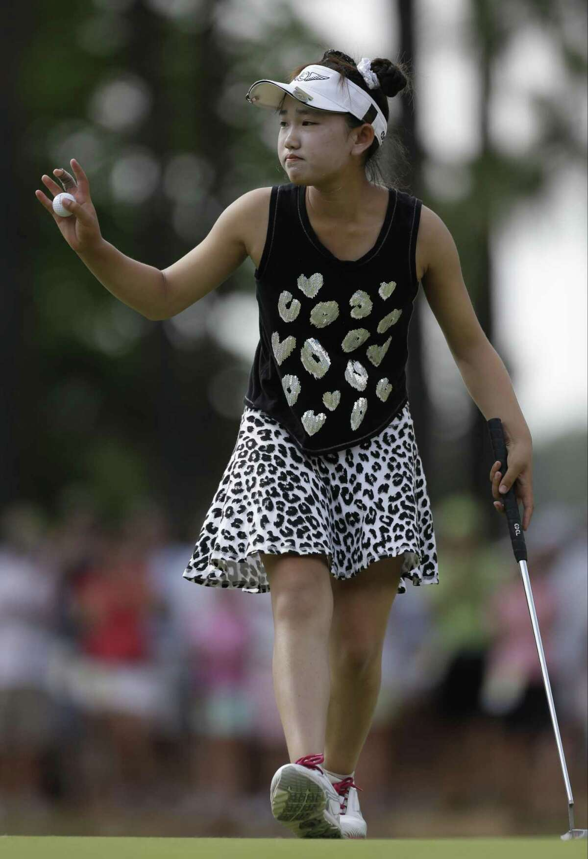 Lucy Li reacts after making a putt on the 13th hole during the second round of the U.S. Women's Open golf tournament in Pinehurst, N.C., in 2014.
