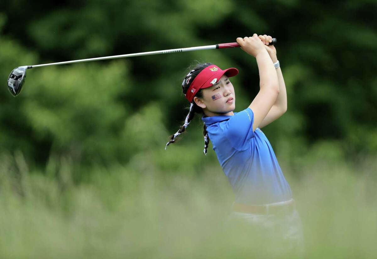 Lucy Li plays her tee shot on the 18th hole in her 2018 Curtis Cup Match with Jennifer Kupcho against the British team of Sophie Lamb and Olivia Mehaffey in Scarsdale, N.Y.