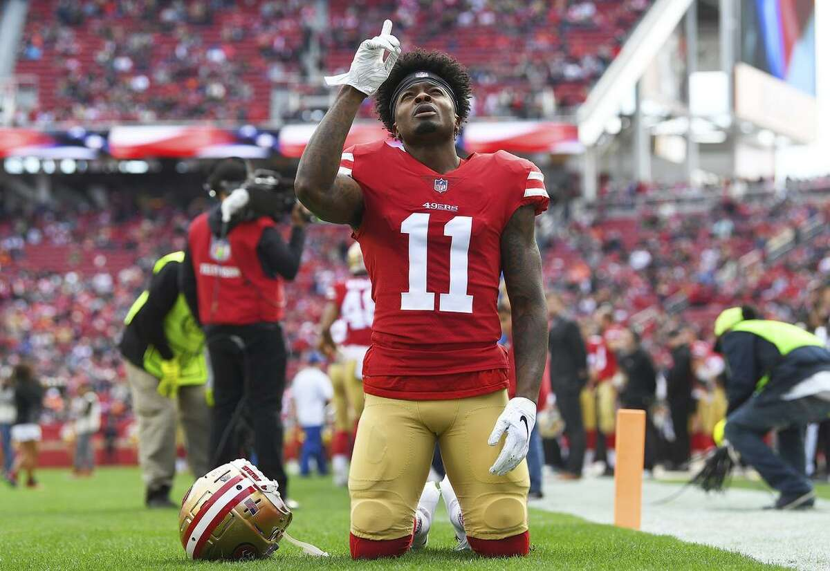 SANTA CLARA, CA - DECEMBER 23: Marquise Goodwin #11 of the San Francisco 49ers kneels in the endzone and prays prior to the start of an NFL football game against the Chicago Bears at Levi's Stadium on December 23, 2018 in Santa Clara, California. (Photo by Thearon W. Henderson/Getty Images)