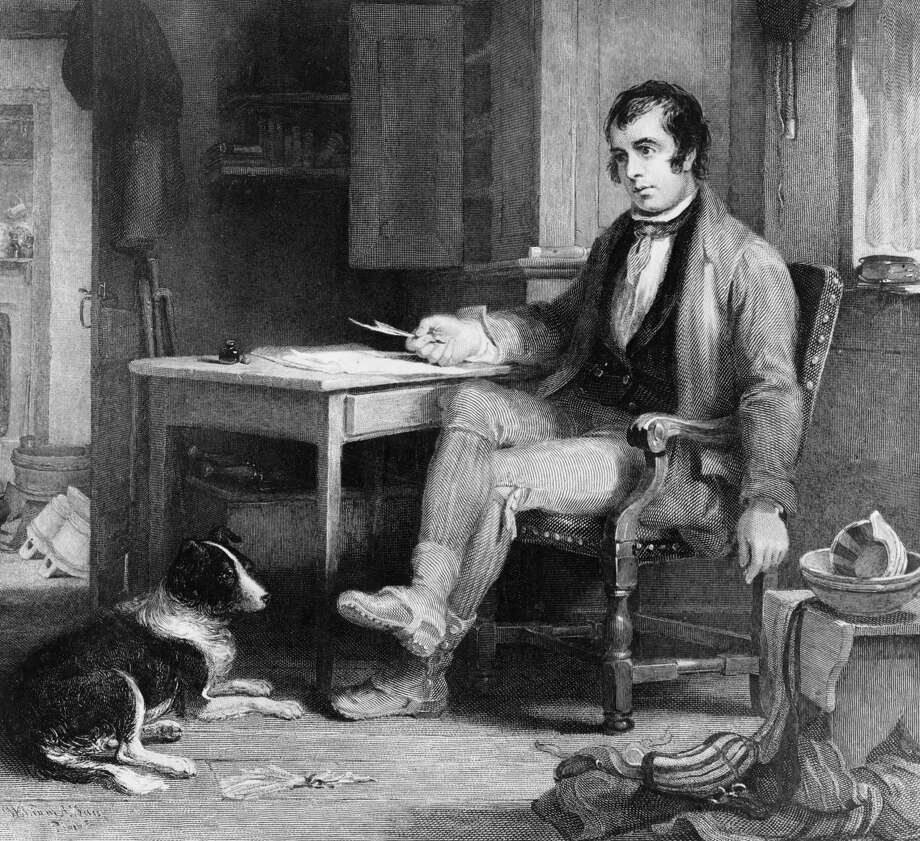Circa 1786:  Scottish poet Robbie Burns (1759 - 1796) in his cottage composing 'The Cotter's Saturday Night'. His life and work are celebrated on Burns Night, 25th January.  (Photo by Hulton Archive/Getty Images) Photo: Hulton Archive / Hulton Archive