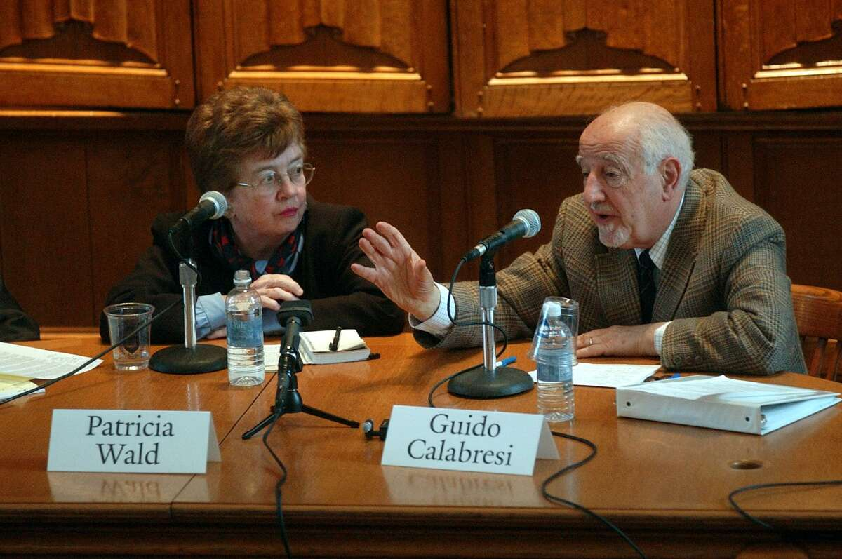 Judge Patricia Wald listens to Judge Guido Calabresi during a confrence on Constitutional issues at the Yale Law School auditorium in this 2005 file photo.