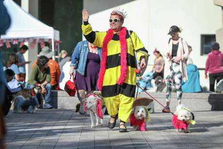 Jill Karnicki and her dogs, Ginger, Jack and Zoe take part in the Royal Paw-Parade