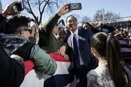 Julián Castro's story has particular resonance in this time and place. Here, the former HUD secretary and mayor greets supporters with his family after announcing he'll seek the Democratic nomination for president.