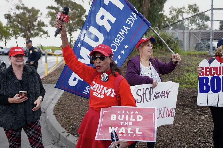 Donald Trump pledged Mexico would paid for the wall, but his supporters, such as these in San Ysidro, Calif., don't care. They care only that the wall is built; that's why Trump can't back down. Photo: Sandy Huffaker / Getty Images / 2019 Getty Images