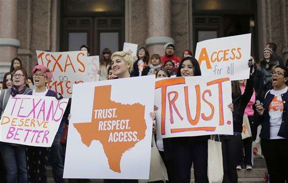In 2015, college students and abortion rights activists hold signs during a rally on the steps of the Texas Capitol, in Austin, Texas. There are a couple measures the Legislature can pass this session to increase abortion access. Photo: Eric Gay /AP / AP