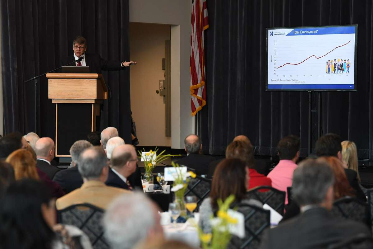 Patrick Jankowski the senior vice president of research for the Greater Houston Partnership speaks to local business leaders Wednesday at the Economic Forecast breakfast. The event was held at Beaumont's Event Centre and offered insight into development of the area. Photo taken Wednesday, 1/16/19