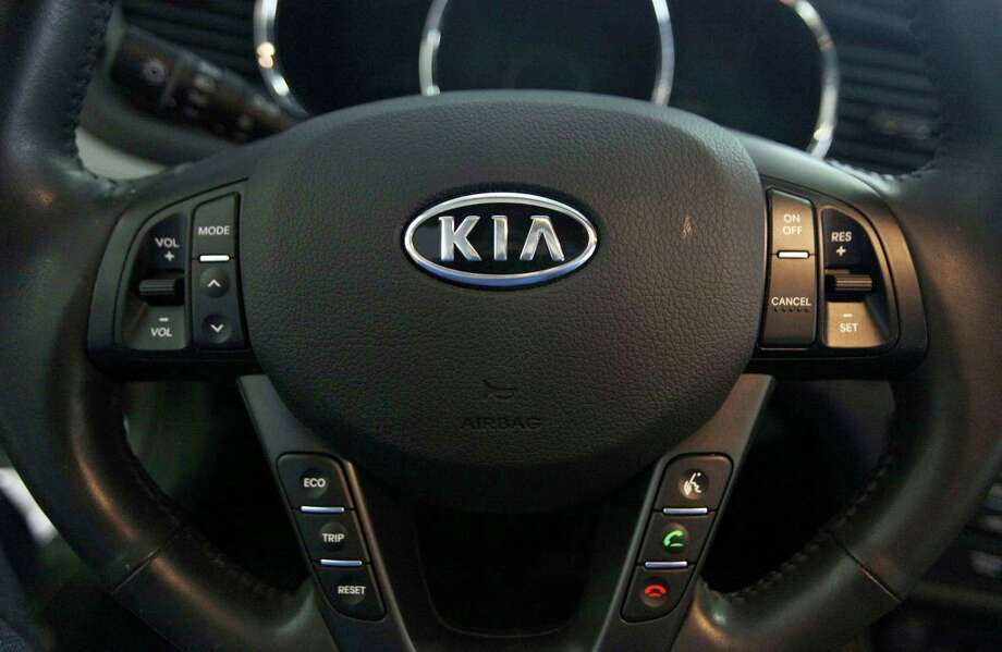 FILE- This Oct. 5, 2012, file photo, shows a Kia optima's steering wheel inside of a Kia car dealership in Elmhurst, Ill. Kia says it will ignore the partial U.S. government shutdown and recall more than 68,000 vehicles to fix a fuel pipe problem that can cause engine fires. The problem stems from previous recall repairs due to engine failures. Kia is only doing the fix on 68,000 of its 618,000 vehicles.  The fuel injector pipe recall covers some 2011 through 2014 Optima cars, 2012 through 2014 Sorrento SUVs, and 2011 through 2013 Sportage SUVs, all with 2-liter and 2.4-liter four-cylinder engines. (AP Photo/Nam Y. Huh, File) Photo: Nam Y. Huh / Copyright 2019 The Associated Press. All rights reserved.