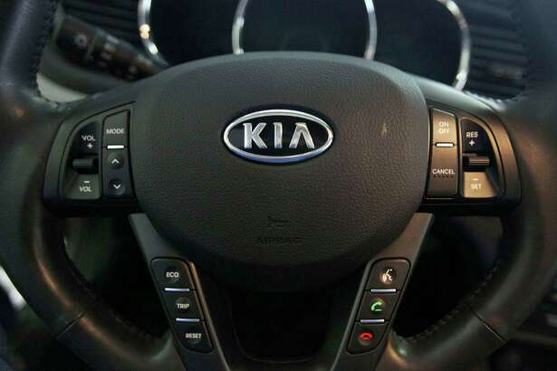 FILE- This Oct. 5, 2012, file photo, shows a Kia optima's steering wheel inside of a Kia car dealership in Elmhurst, Ill. Kia says it will ignore the partial U.S. government shutdown and recall more than 68,000 vehicles to fix a fuel pipe problem that can cause engine fires. The problem stems from previous recall repairs due to engine failures. Kia is only doing the fix on 68,000 of its 618,000 vehicles. The fuel injector pipe recall covers some 2011 through 2014 Optima cars, 2012 through 2014 Sorrento SUVs, and 2011 through 2013 Sportage SUVs, all with 2-liter and 2.4-liter four-cylinder engines. (AP Photo/Nam Y. Huh, File)